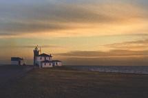 light house building at sun set