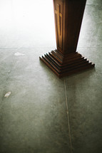 bottom of a wood bible stand