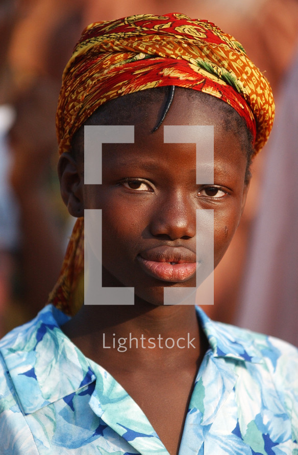 African girl in local traditional headdress {Try search for Ethnic Faces}