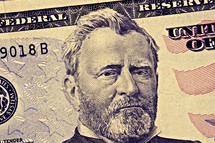 A closeup of a fifty dollar bill