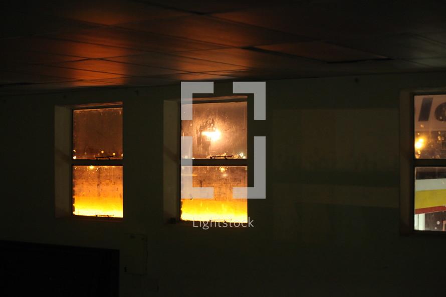 lights glowing through a window