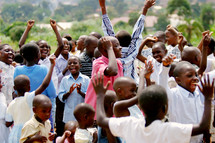 Group of African children youth  praising God joy dancing