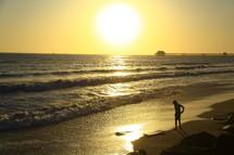 large setting sun over a beach