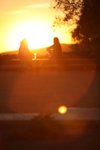 Sitting on bench at sunset
