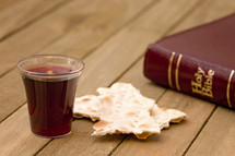 Bible, communion bread and wine cup