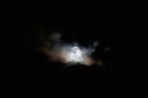 moon peeking through the clouds
