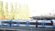 man reading a Bible watching a train