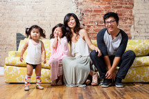 Asian family sitting on a couch