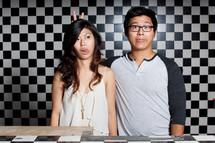 Asian couple acting silly