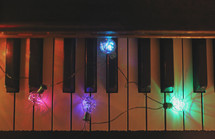 Christmas lights on a piano