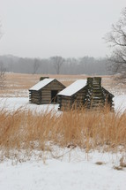 Valley Forge log cabins in the snow