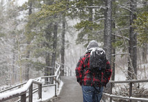 man backpacking in snow