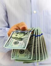 man holding a large amount of money