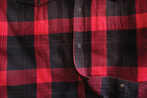 A red and black plaid shirt.