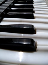 Upclose view of an electronic keyboard piano keys in black and white to make music for live praise and worship services in church, recorded music or on tour on a live stage for Christian bands or praise and worship bands.