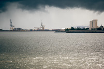 gray smoke over an industrial harbor