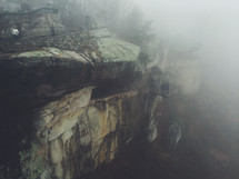 looking out over the edge of a cliff in fog