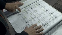 a builder reviewing blueprint plans