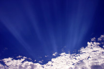 sunlight through the clouds white blue sky