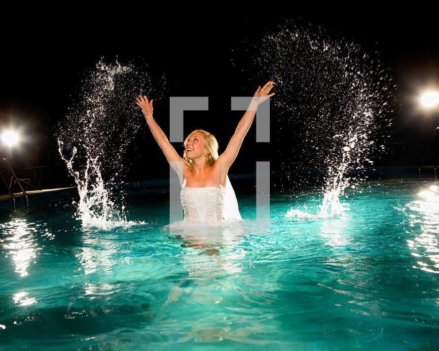 bride splashing in a pool