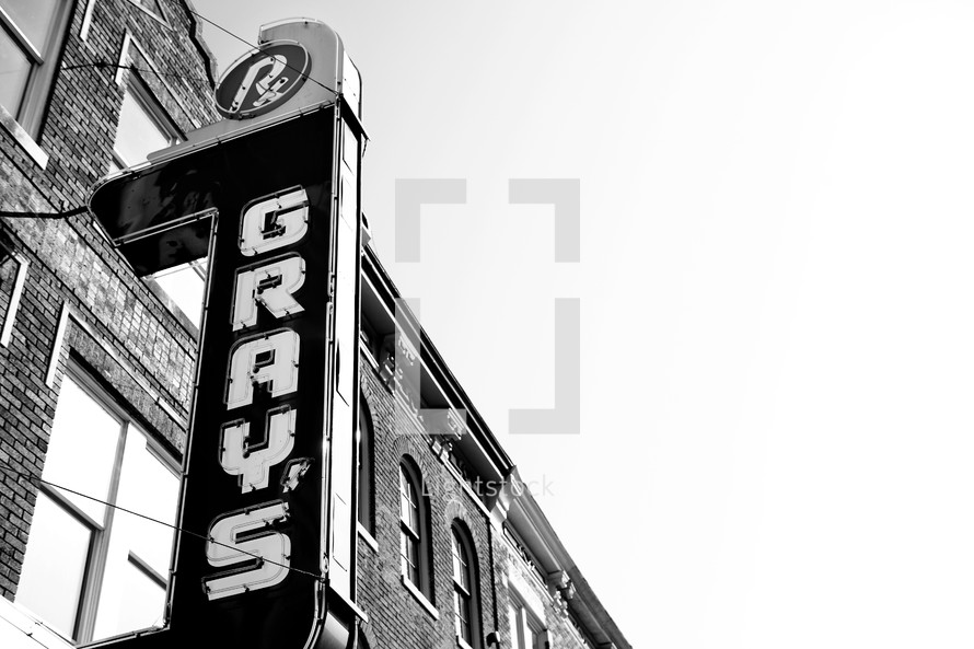 Grays' drug store marquee sign against building.