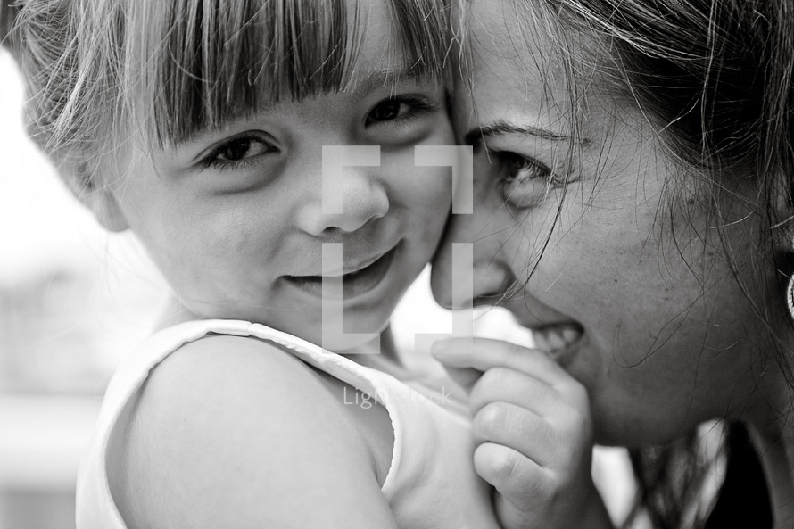 Happy mother and toddler daughter