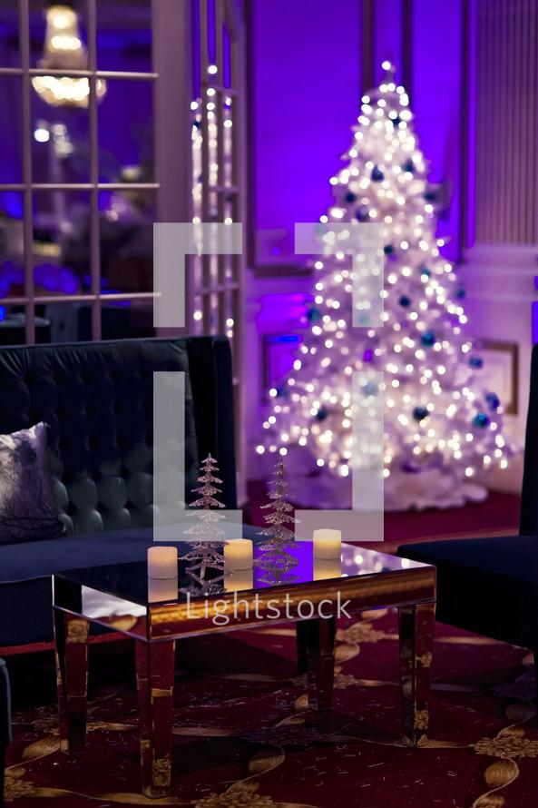 holiday christmas lounge area lights on a white Christmas tree