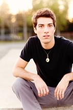 Young man sitting teen model fashion brown hair Caucasian white