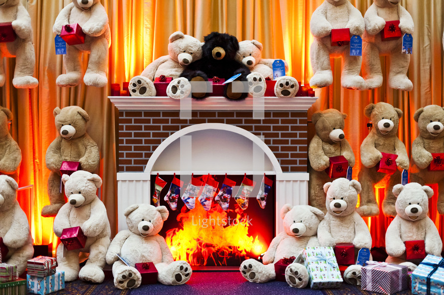 teddy bears in front of a fireplace with stockings hanging on the mantle christmas holiday