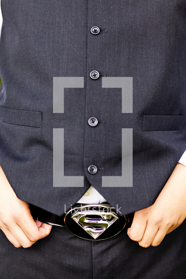 buttons on a vest with a superman belt buckle
