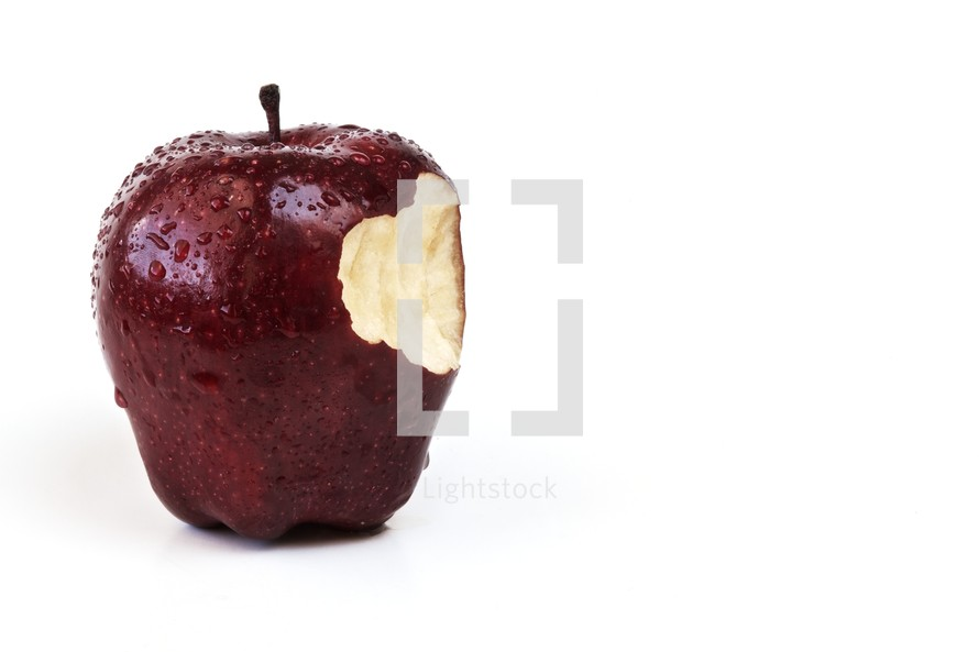 Bite out of an apple isolated on white