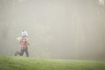 a girl running in the grass