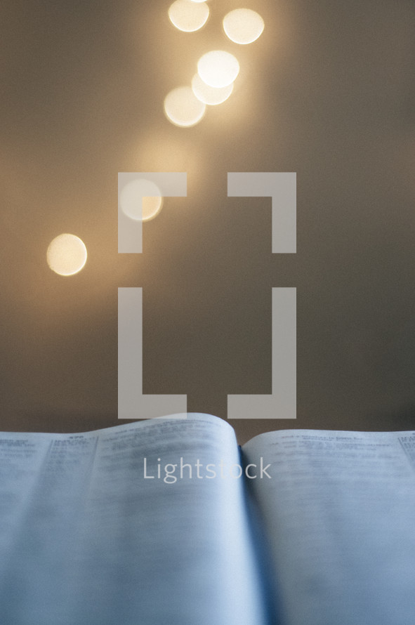 bokeh lights and open Bible