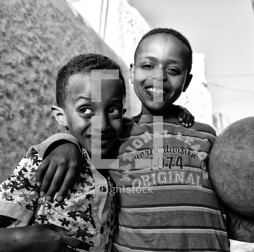 smiling children with a ball in Ethiopia