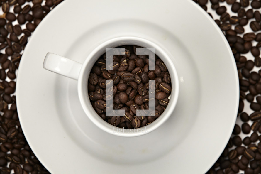 Coffee beans inside a white mug