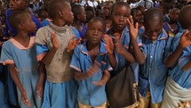 kids clapping and dancing to music during a worship service