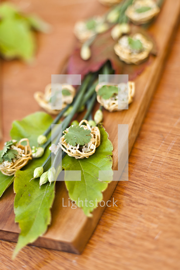 Appetizer Arrangement on wooden block and green leaves