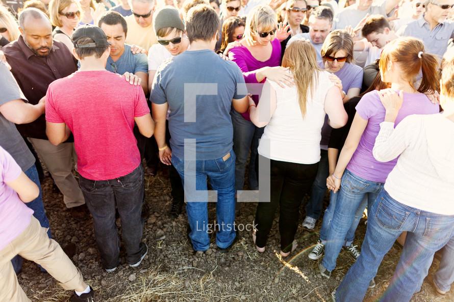 Group prayer crowd salvation believers standing hands