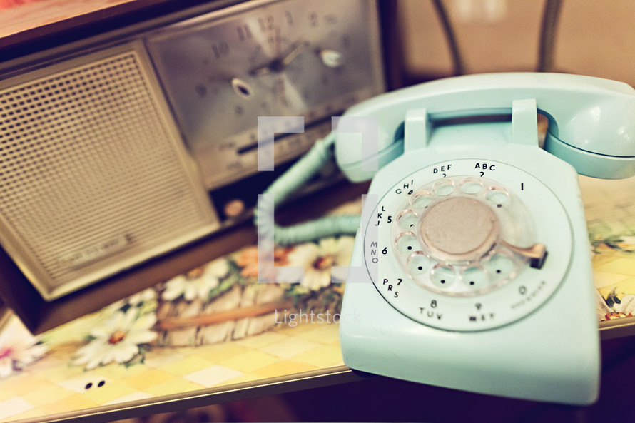 Rotary telephone and vintage radio