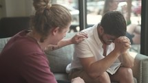 men's group Bible study, men discussing scripture and praying