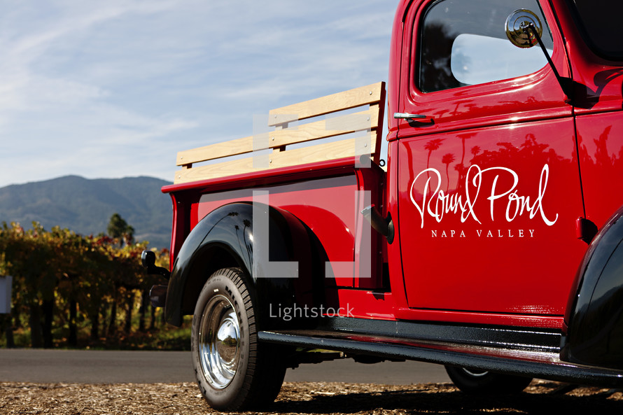 Old classic Truck parked at vineyard red