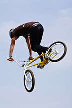 man doing stunts on a trick bike BMX x games