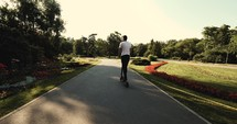 man on a scooter in a park