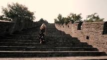 a woman walking up steps