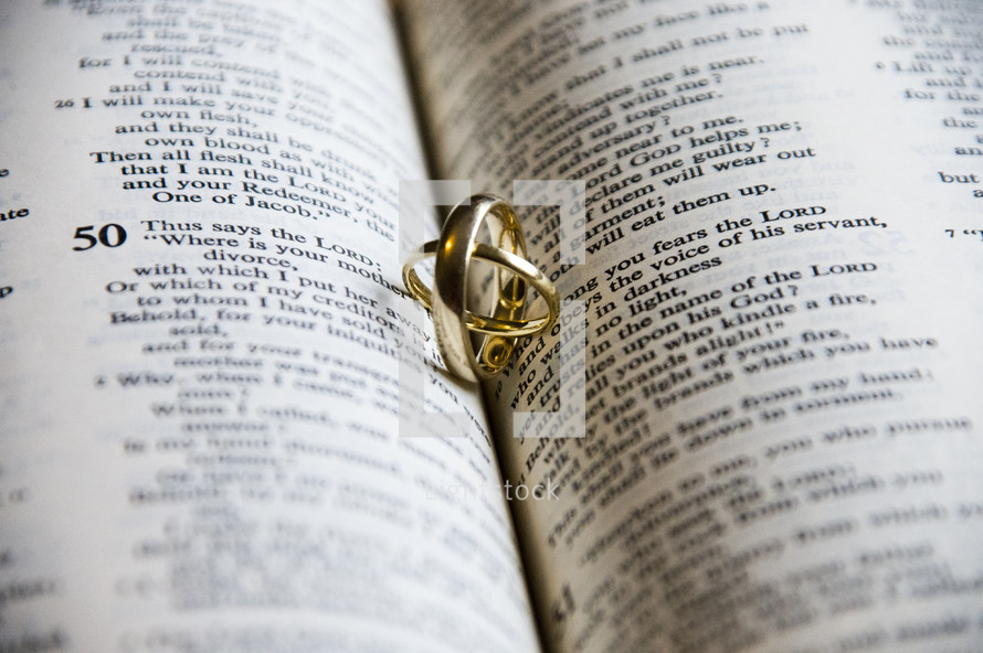 wedding bands on the pages of a Bible