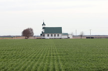 a church and farmland
