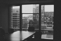 View of city buildings from an office window.