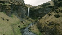 mountain waterfall and river in a canyon