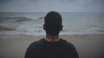 a man looking out at the ocean