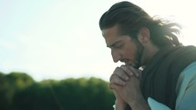 Jesus praying outdoors